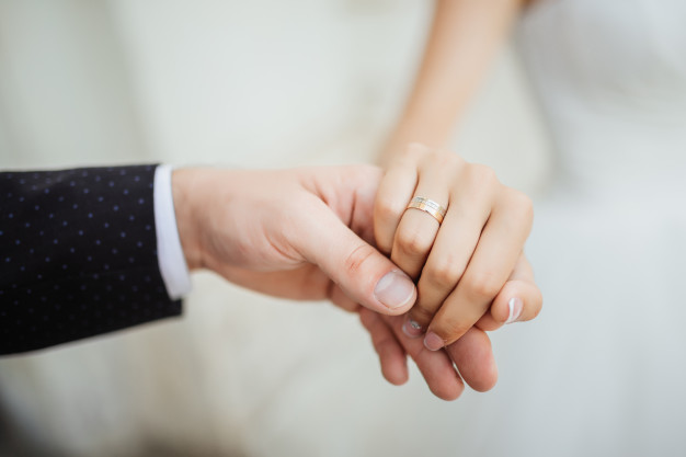 wedding-moments-newly-wed-couple-s-hands-with-wedding-rings_8353-5792
